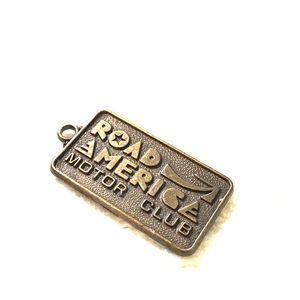 Bronze Road America 2 inch pendant 1970s vintage